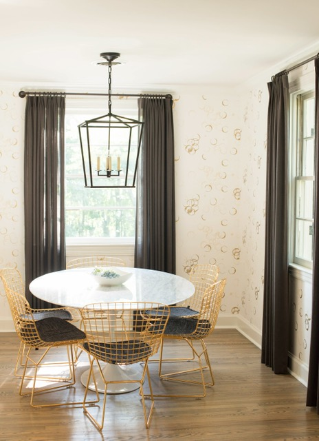 The wallpaper is clusters of wine glass rings - how fun and appropriate for a dining room?
