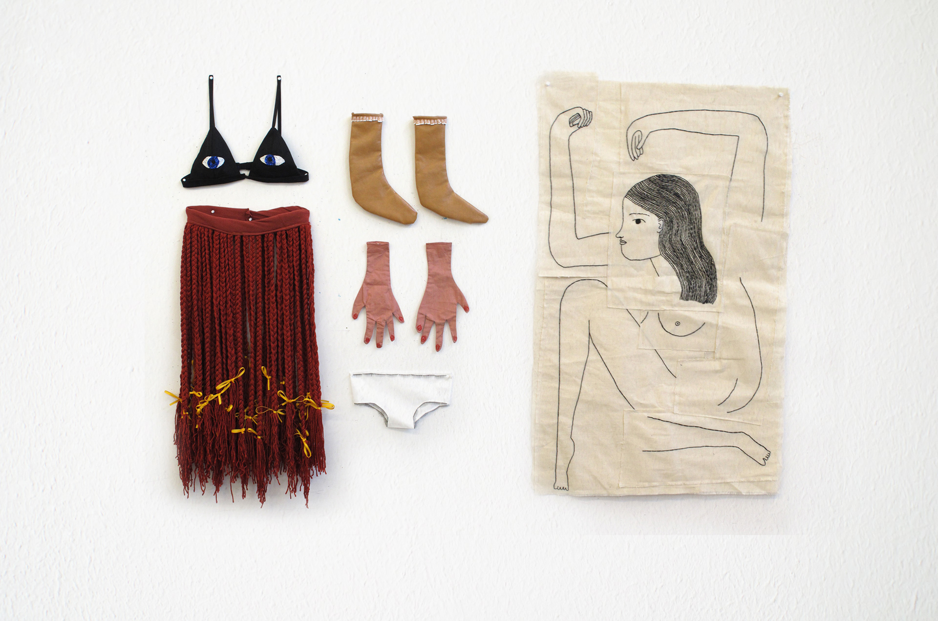 """Chelsea O'bryne    Identity Suit/I looked inside myself and saw what wasn't there, 2016   mixed textile media, glue, fake nails, fake eyelashes and beads, embroidery on canvas  10.2"""" x 11.3"""" (bra); 7.5"""" x 8.7"""" (underwear); 11.4"""" x 23.6"""" (skirt); 7.3"""" x 10.2"""" (sock, each); 5""""x 9.6"""" (glove, each); 21"""" x 32"""" (canvas)"""