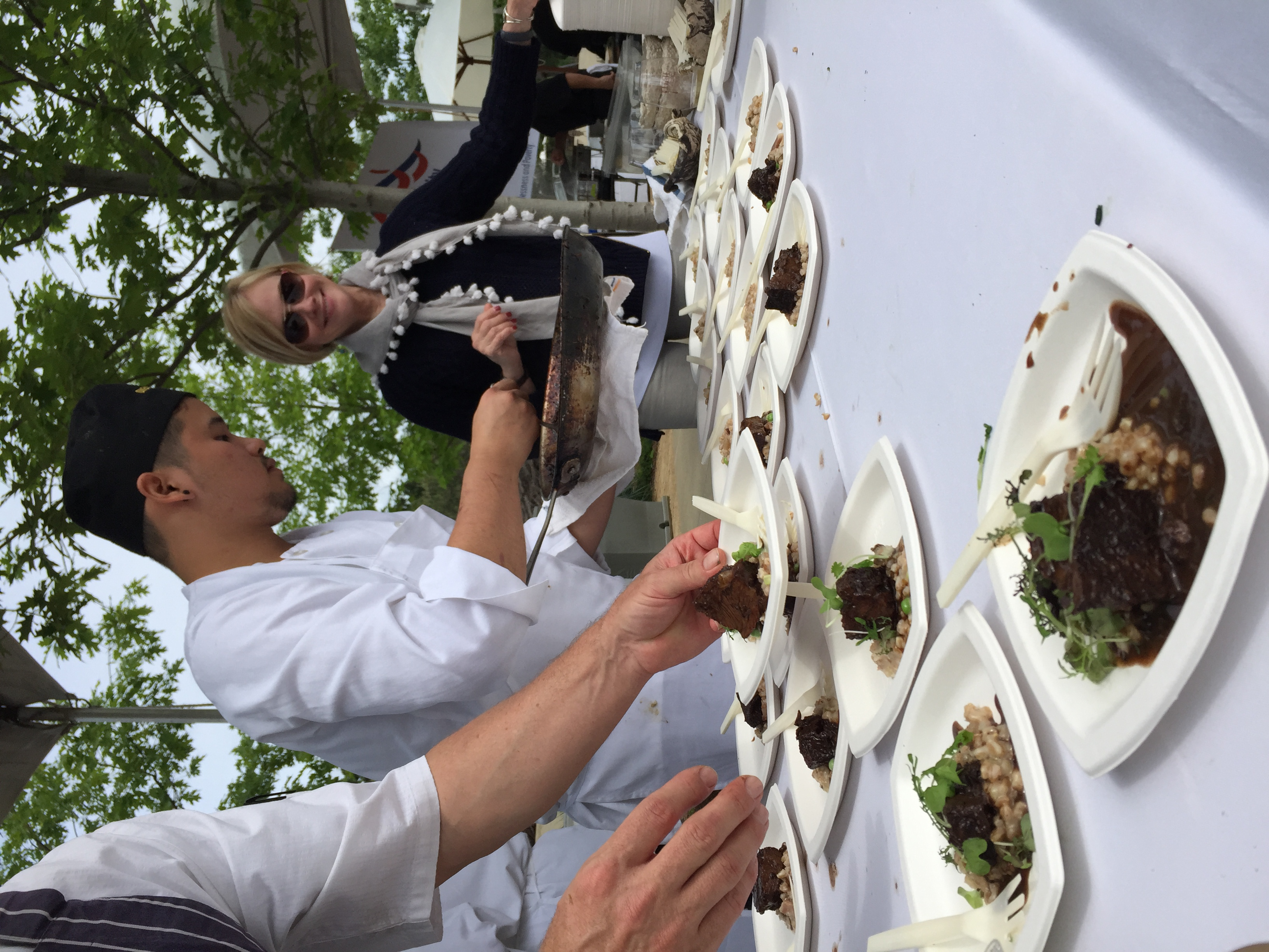 The chefs finishing the oxtail risotto.