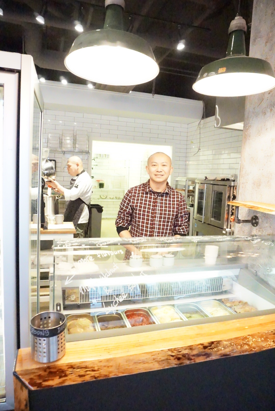 Tangram co-owner Mike Wong and his pastry chef, Kazushi Terakawa in the background.