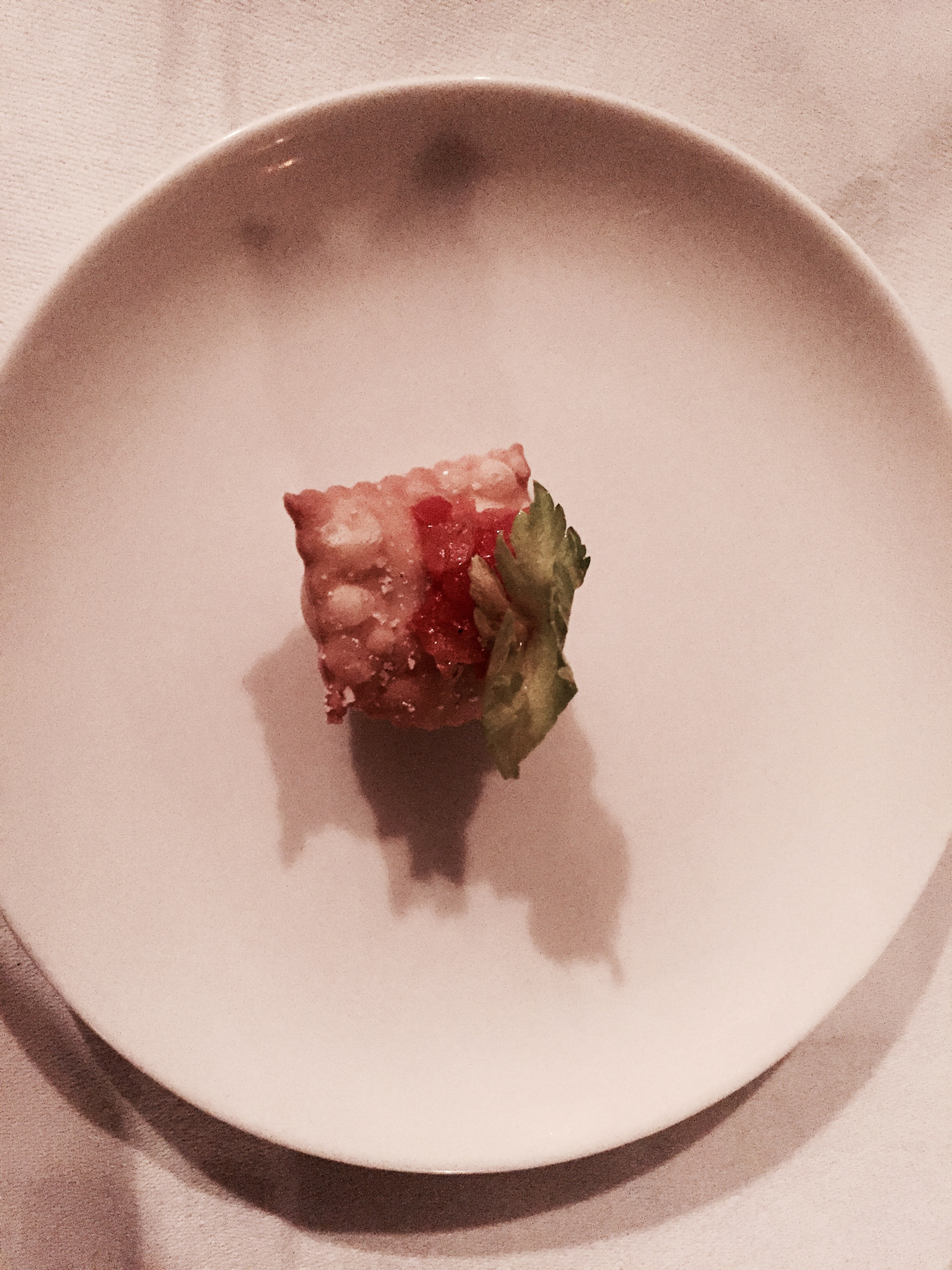 An amuse bouche of puff pastry and fresh vegetables
