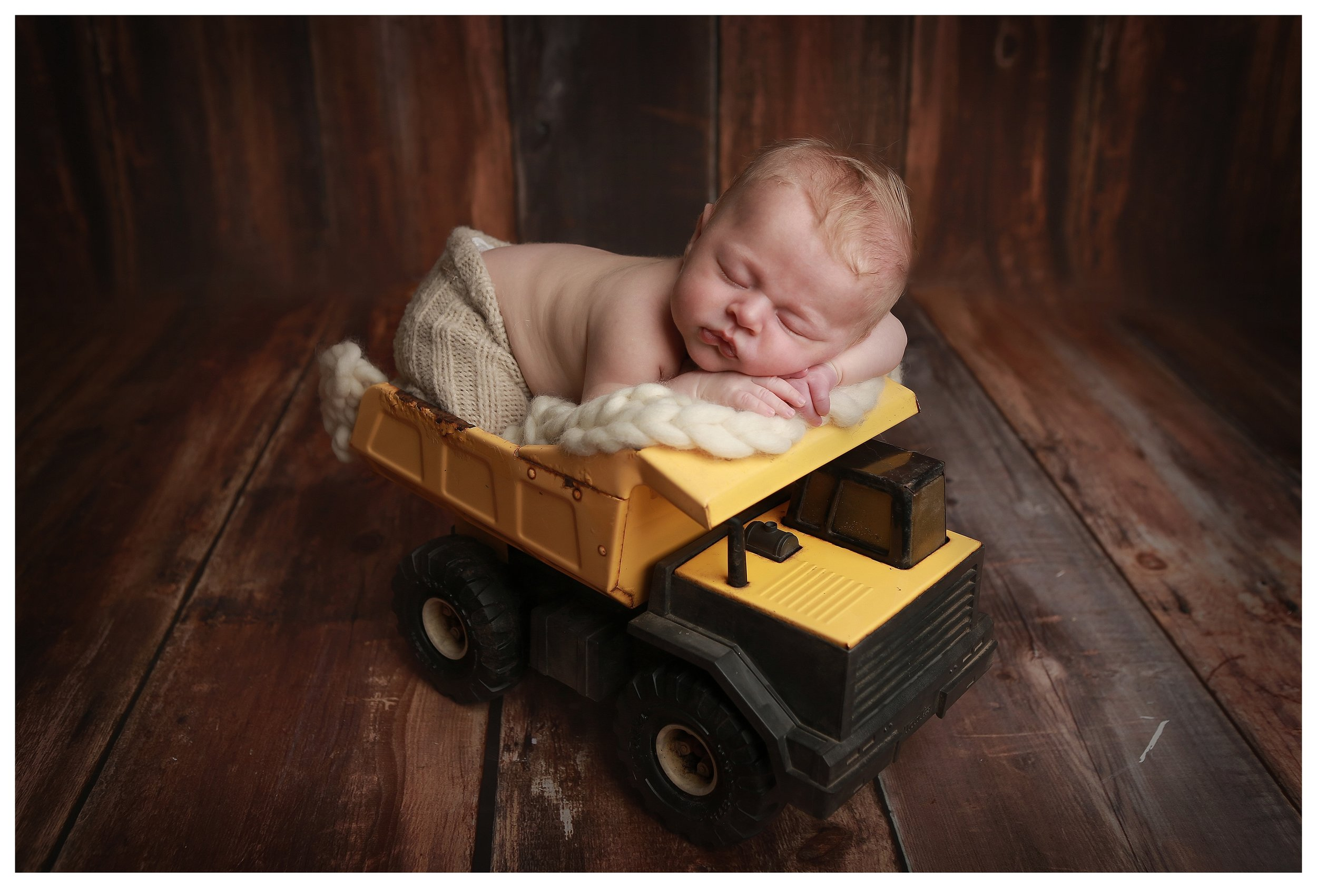 For the all around little boy pose i have a dump truck to place baby in.