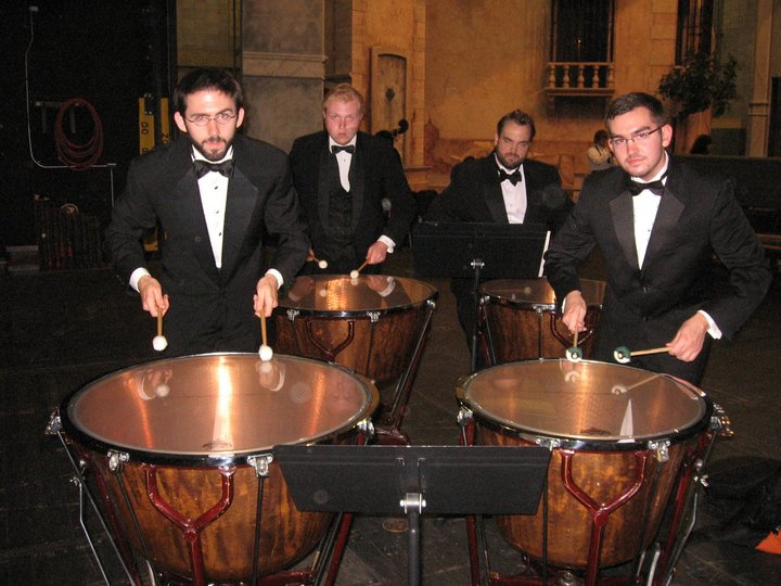 """Indiana University Philharmonic Percussion section Ross Erickson, JJ Pearse, myself, and Nick Stevensplaying the """"Storm movement of Berlioz's Symphony Fastastique."""