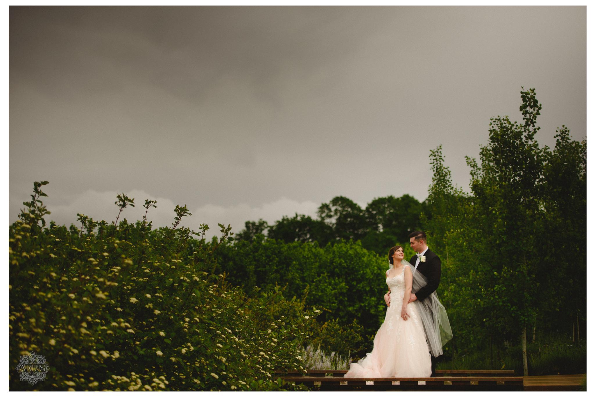 AriusPhoto-Penn-State-Wedding-Arboretum-Bride-Groom-Portrait-Cloudy-Sky-2.png