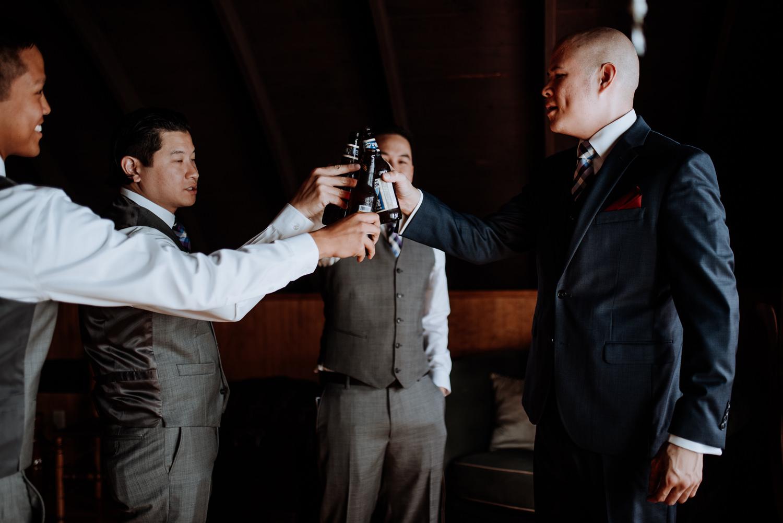 groomsmen cheers their beers