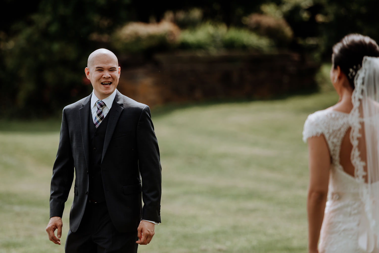 grooms reaction during first look at Red Maple Vineyard Wedding