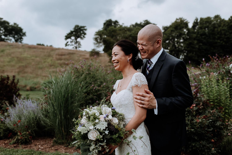 Red Maple Vineyard Wedding Photos, bride and groom candid