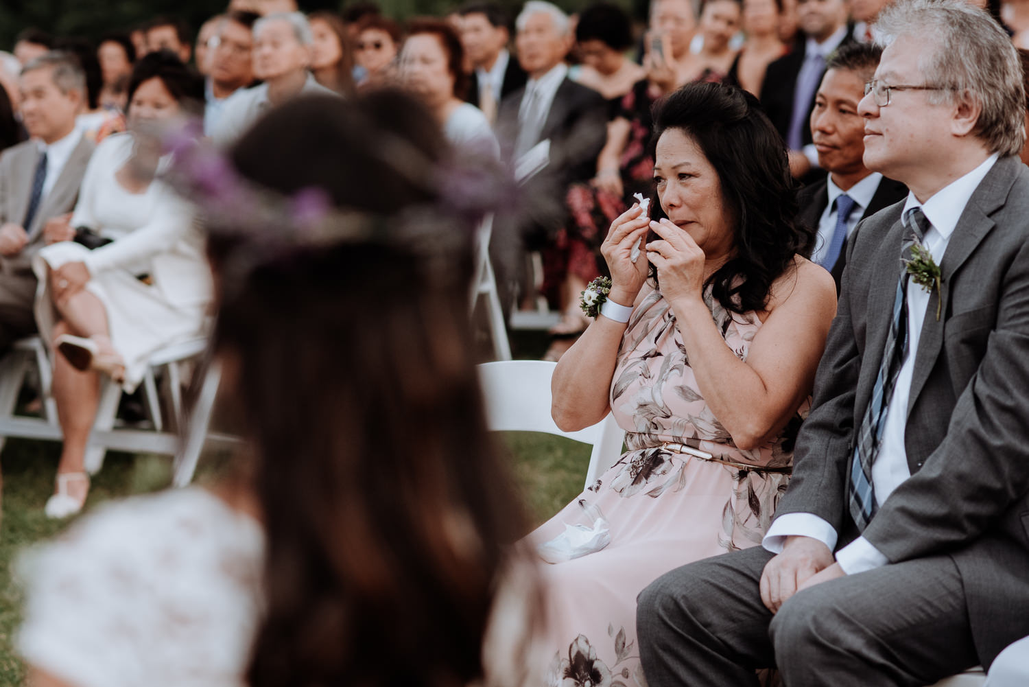 mother cries during wedding ceremony