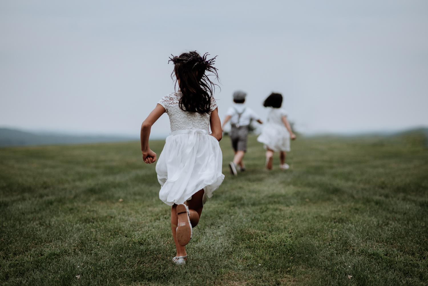 kids run in field at red maple