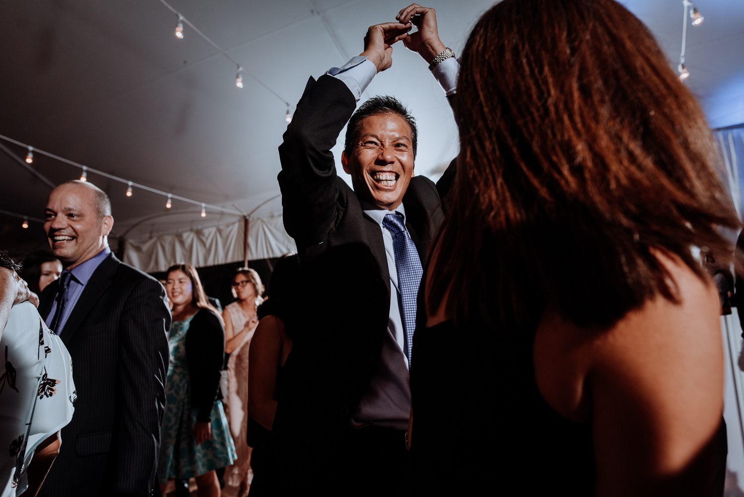 guests dance at red maple wedding