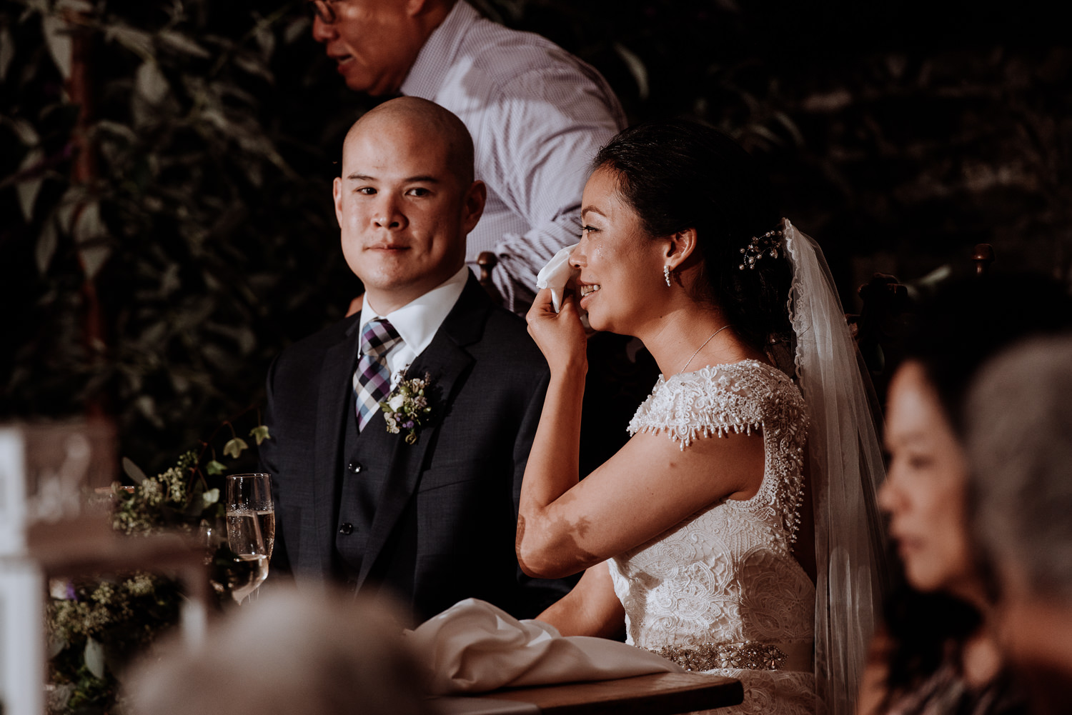 bride wipes tears during toast