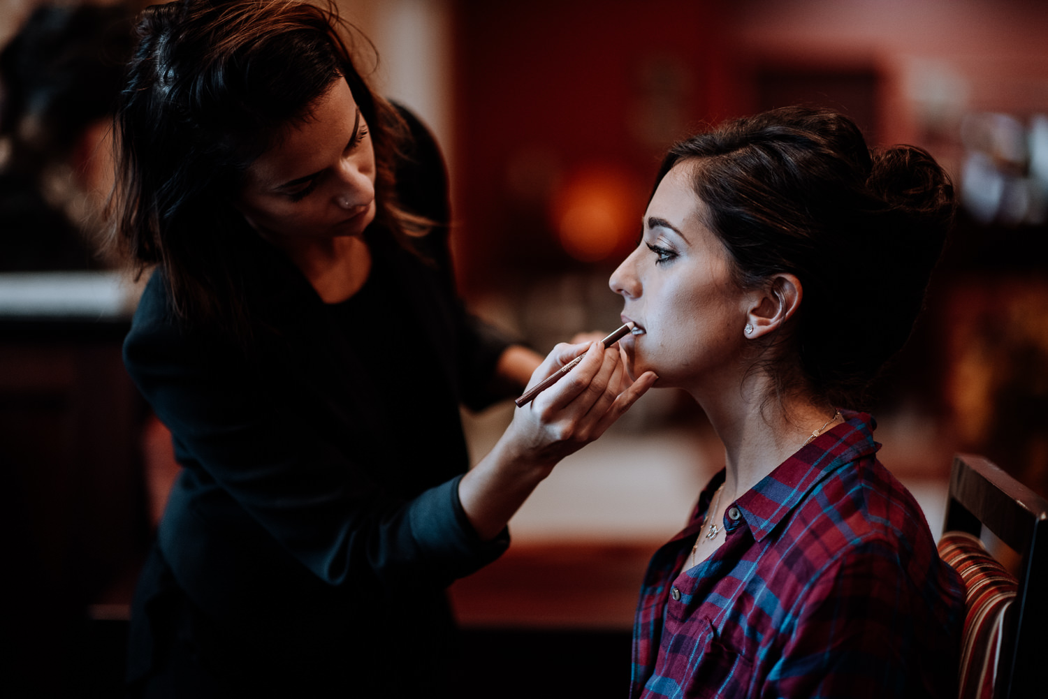 Bride gets her makeup professionally done before her wedding at Red Maple Vineyard