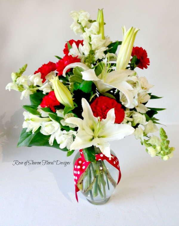 White Lilies and Stock with  Red Carnations, Rose of Sharon Floral Designs