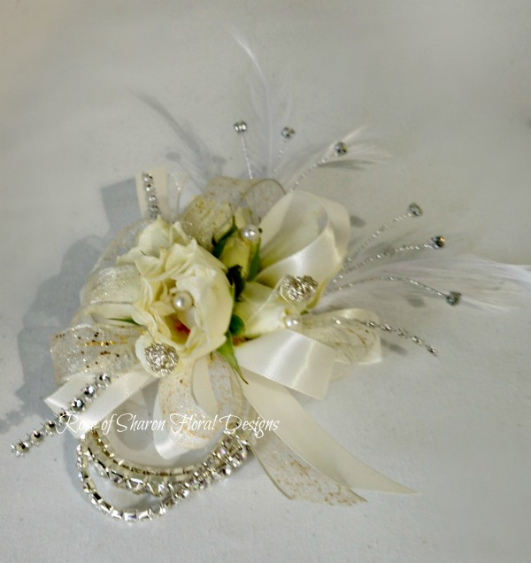 White and Gold Wrist Corsage with Roses and Feather Accents, Rose of Sharon Floral Designs
