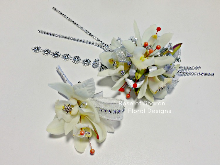 White Orchid Corsage and Boutonniere with Orange and Dazzle Accents, Rose of Sharon Floral Designs