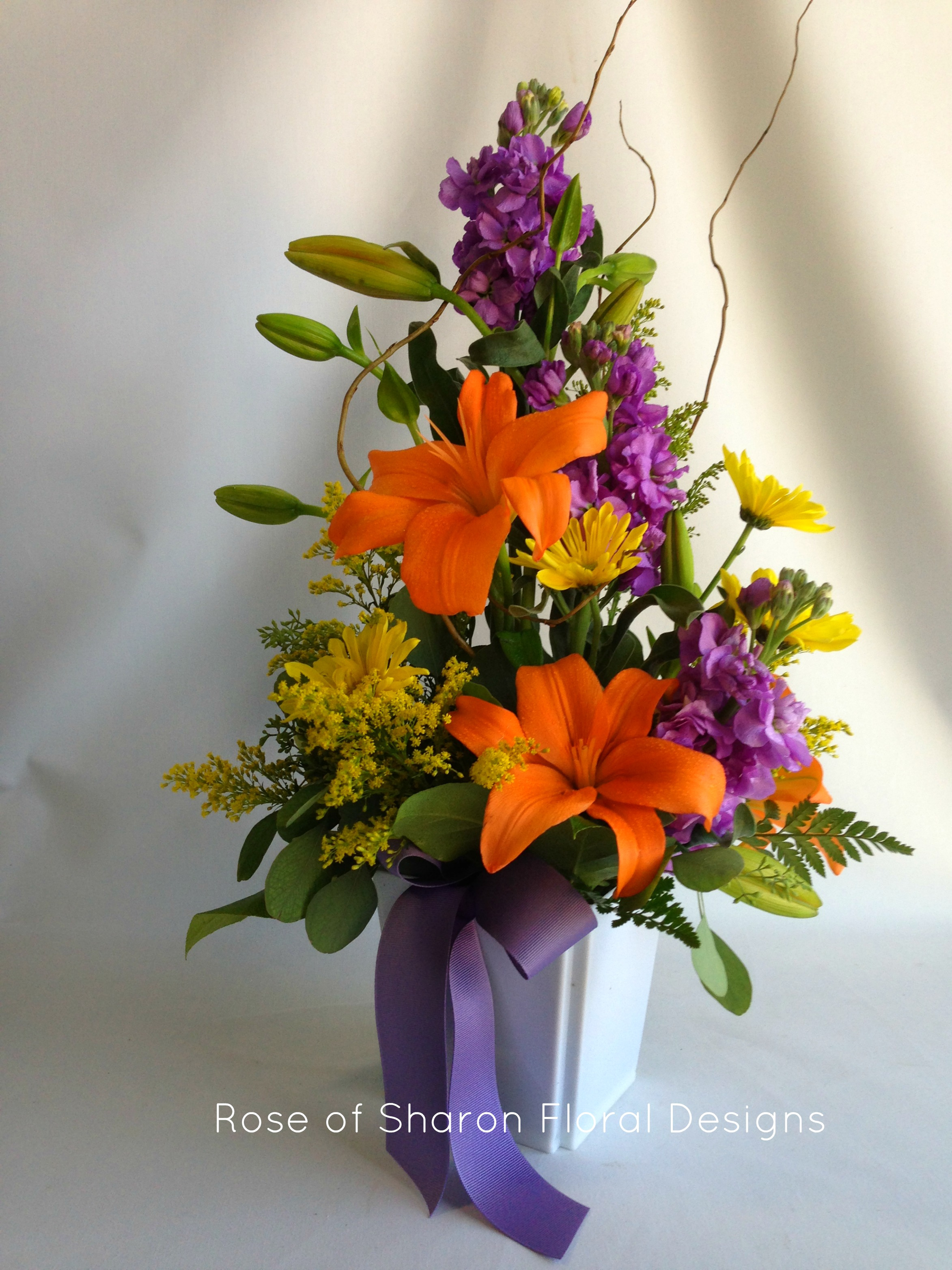 Lilies, Solidago and Stock, Rose of Sharon Floral Designs