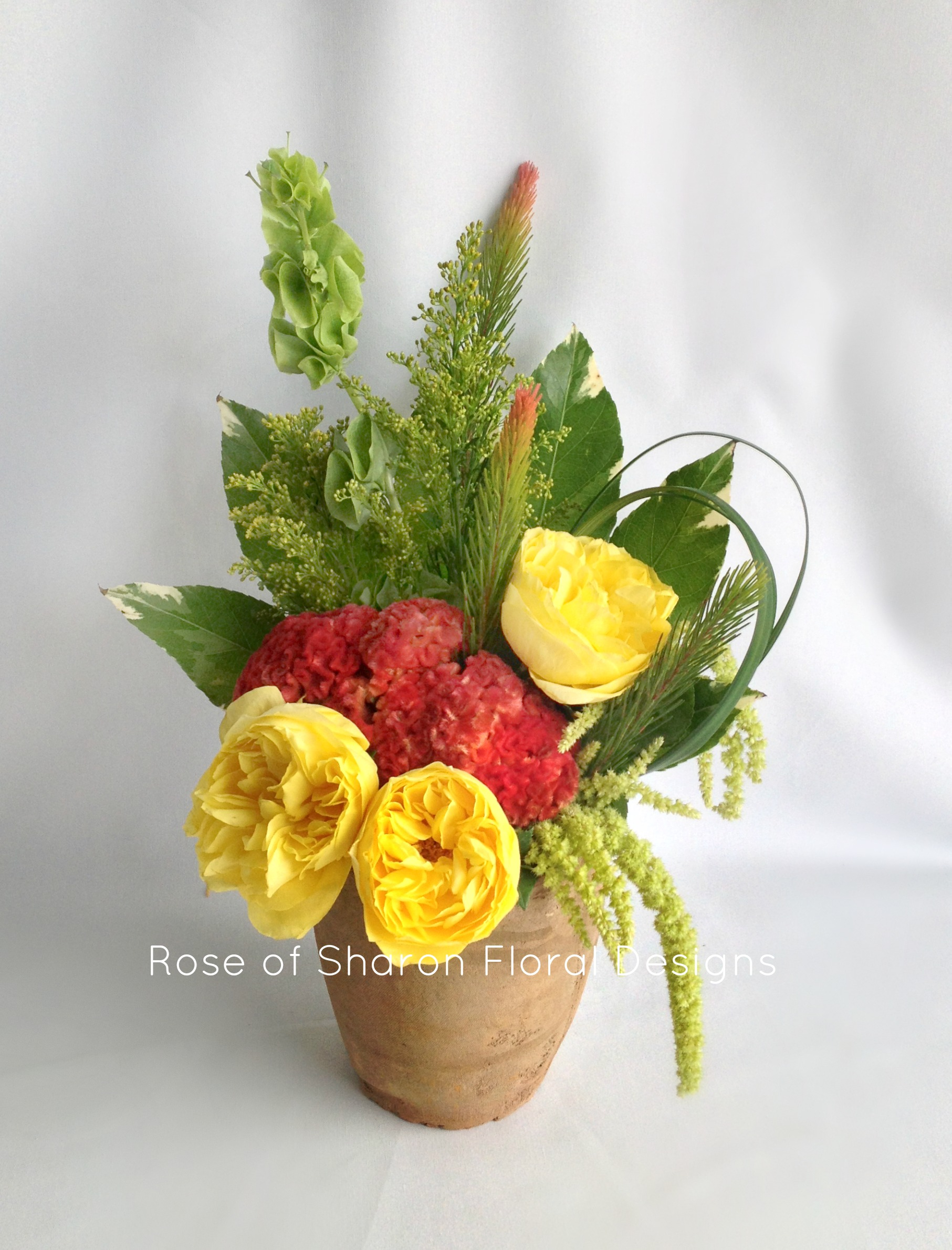 Bells of Ireland, Garden Roses and Carnations, Rose of Sharon Floral Designs