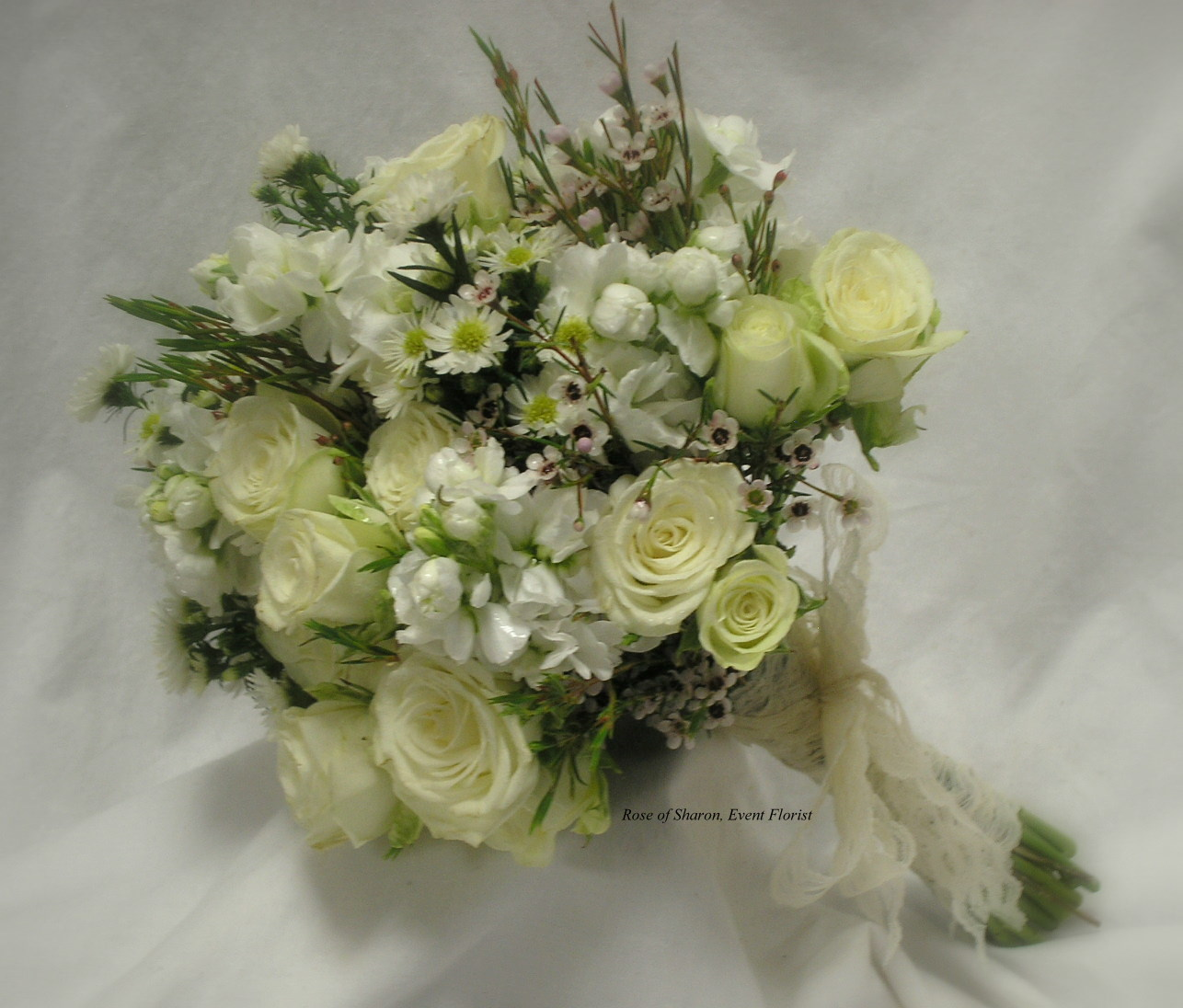 Hand-Tied Bouquet. White Spray Roses, Wax Flower, Stock & Asters. Rose of Sharon Floral Designs