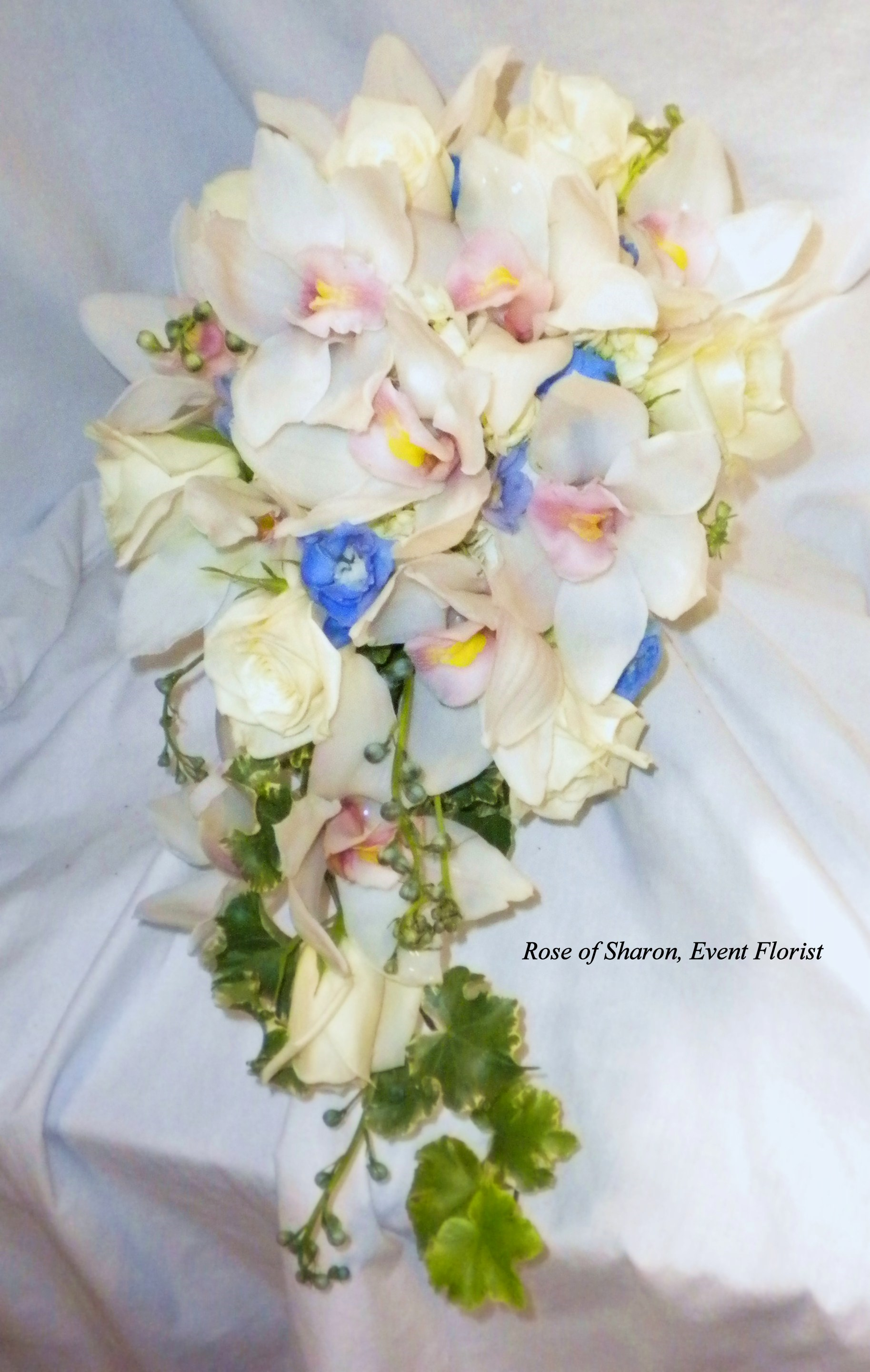 Teardrop Rose and Orchid Bouquet with blush & blue accents. Rose of Sharon Floral Designs