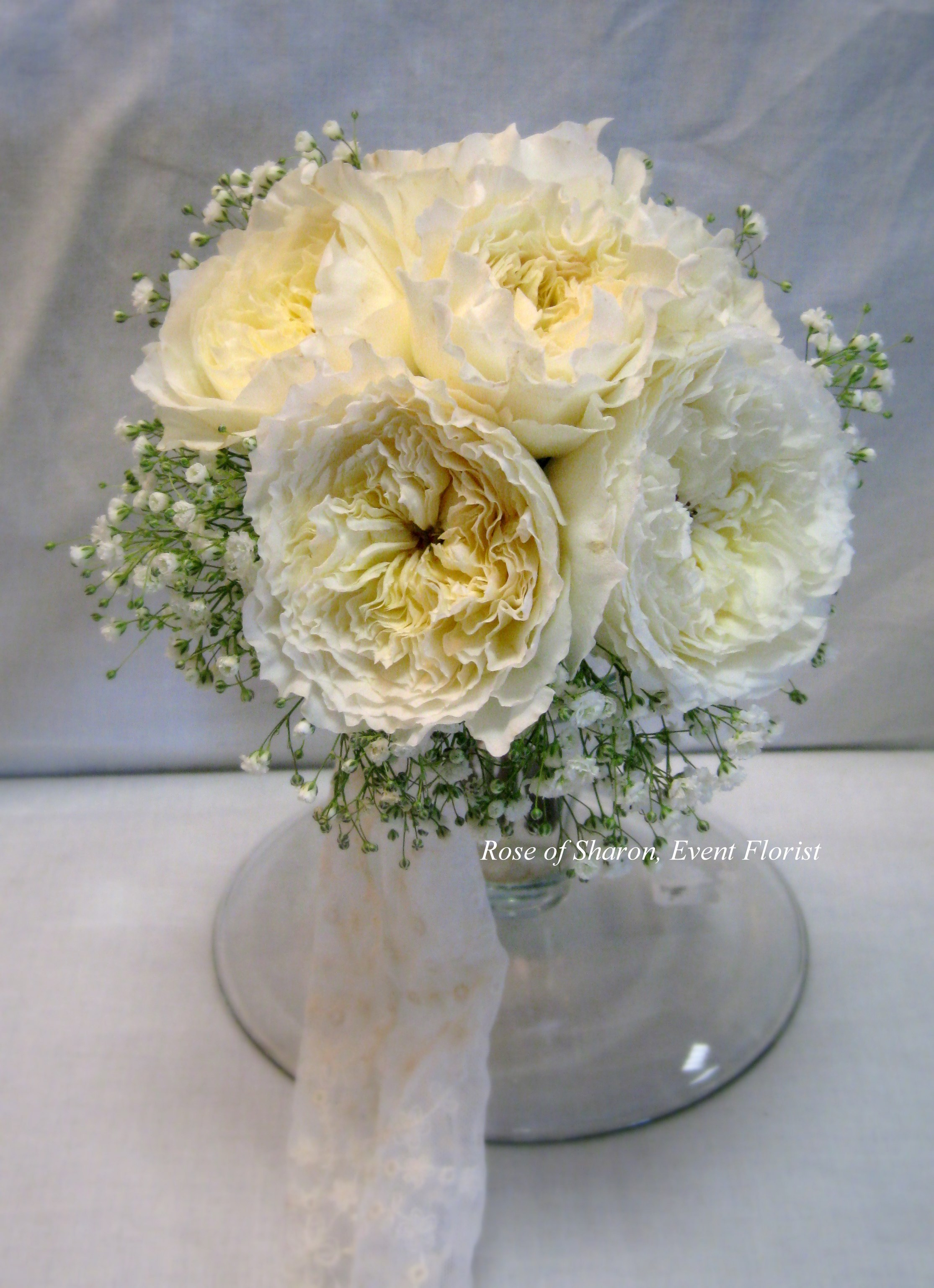 Hand-Tied Bouquet. White Garden Roses and Baby's Breath. Rose of Sharon Floral Designs