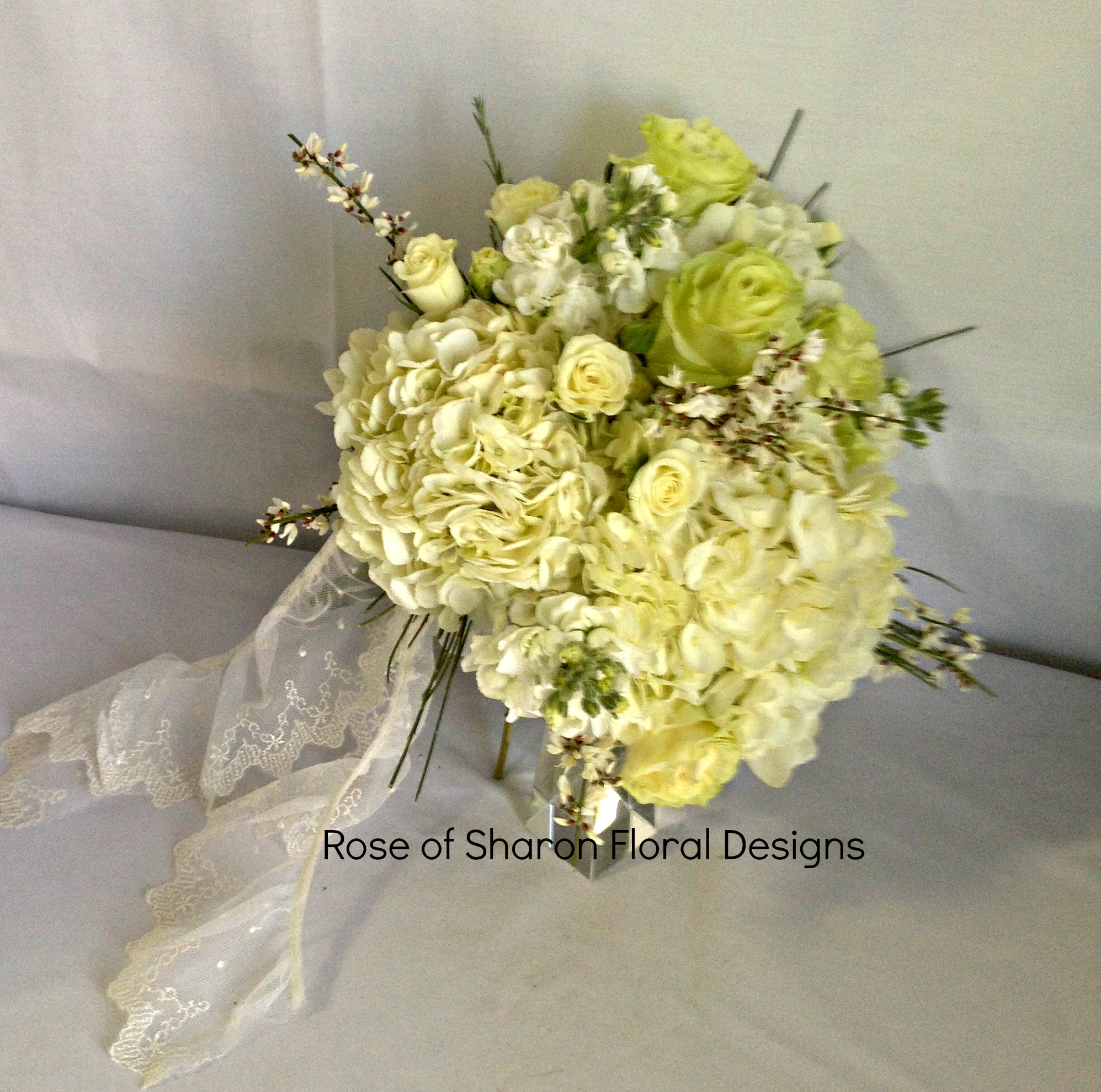 Hand-Tied Bouquet. White Hydrangeas, Roses & Stock. Rose of Sharon Floral Designs