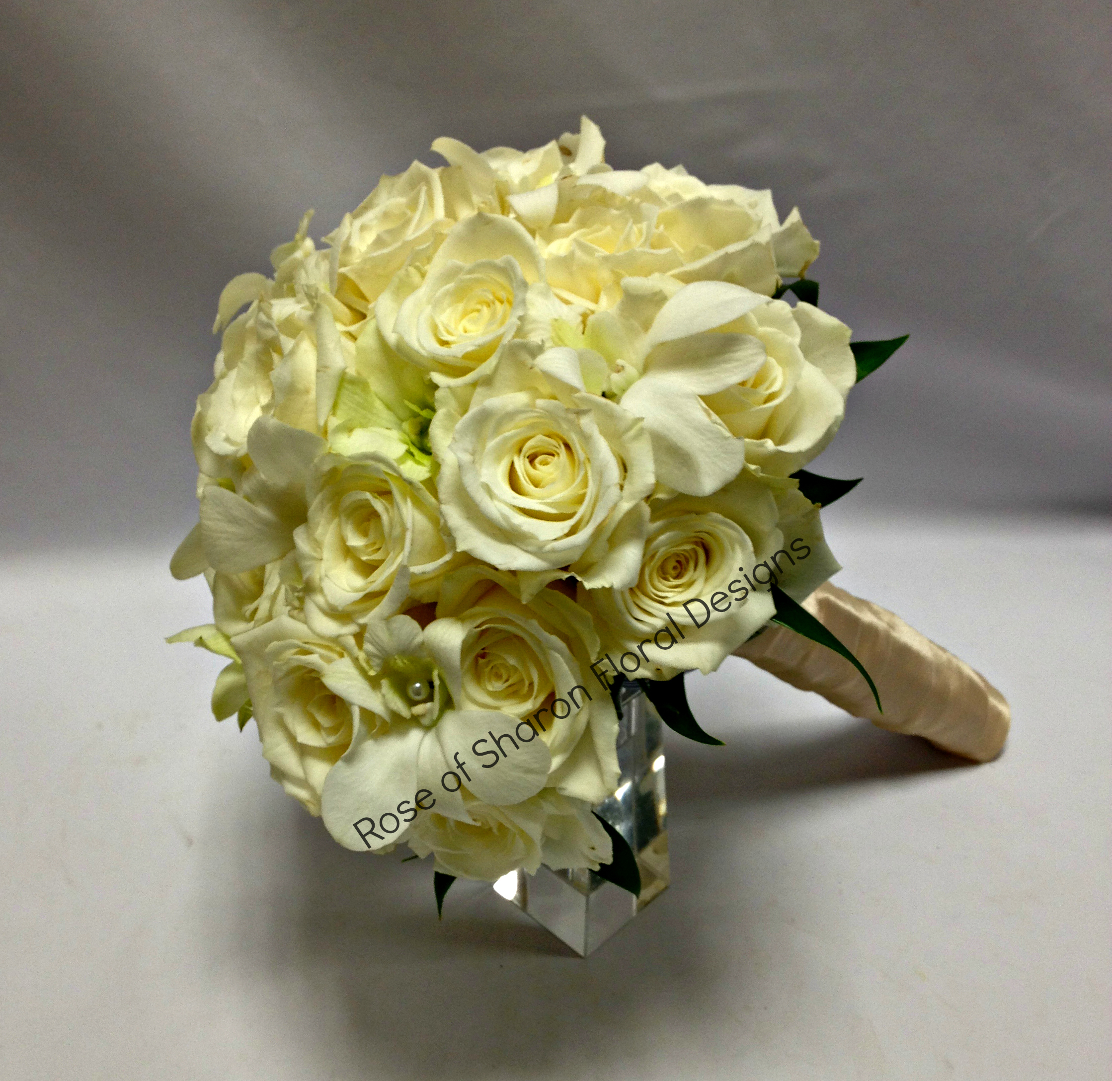 Hand Tied Bouquet. White Roses and Orchids. Rose of Sharon Floral Designs