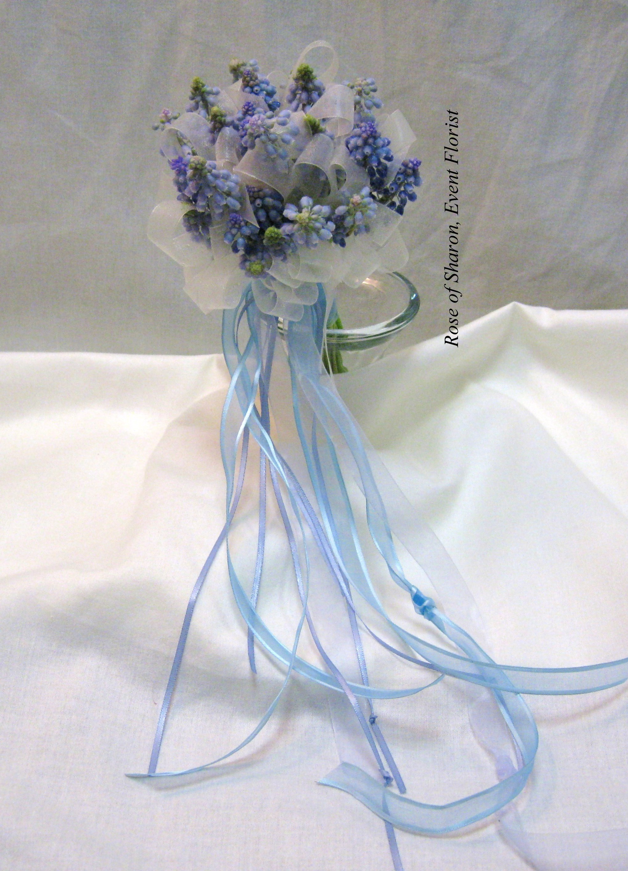 Blue Hand-Tied Grape Hyacinth Bouquet with Ribbon Accents. Rose of Sharon Floral Designs