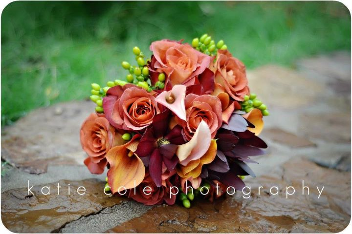 Orange and Burgundy Hand-Tied Bouquet with Roses, Calla Lilies & Hypericum, Katie Cole Photography. Rose of Sharon Floral Designs
