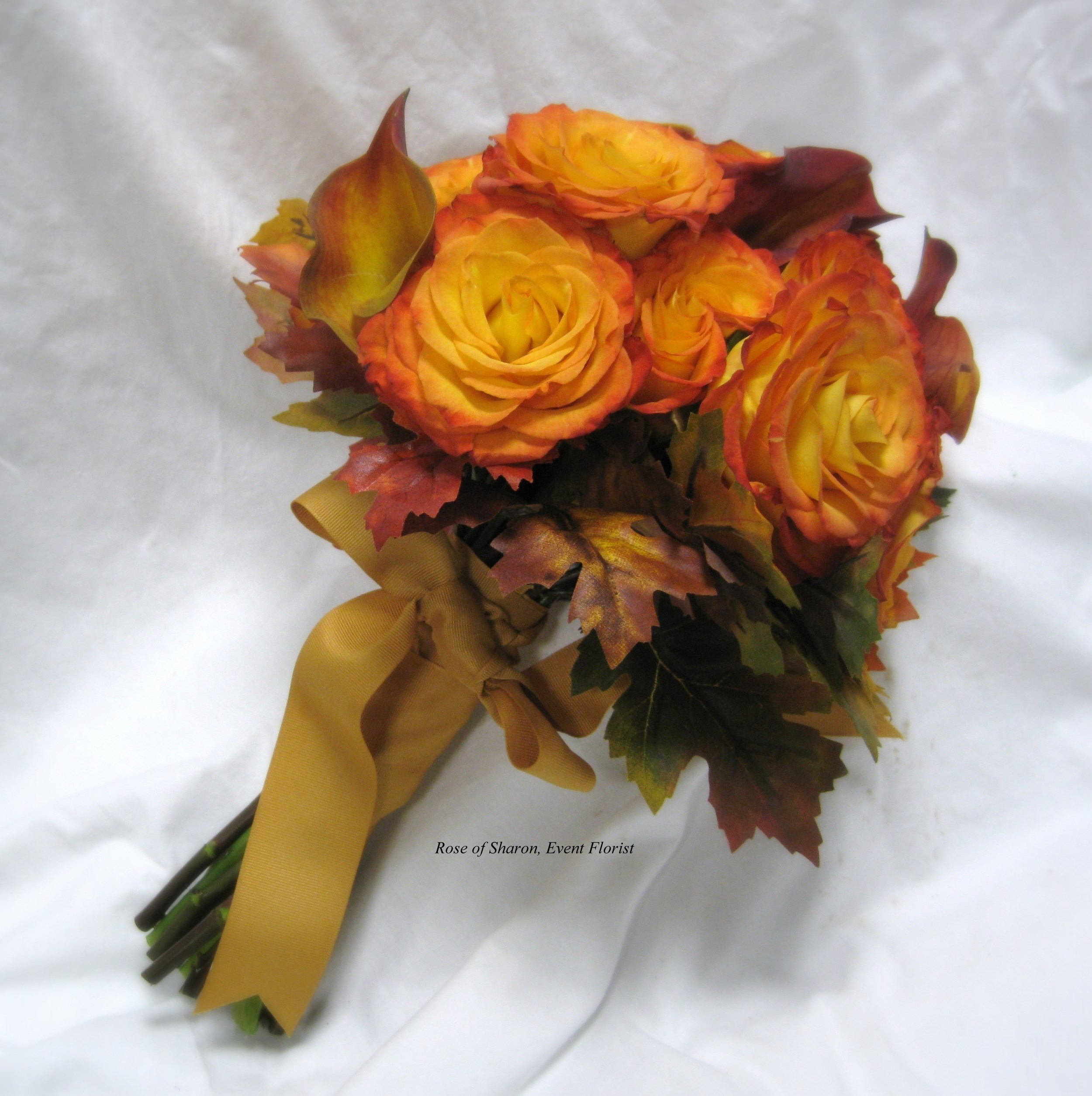 Orange Hand-Tied Bouquet with Calla Lilies, Free Spirit Roses & Autumn Leaves. Rose of Sharon Floral Designs