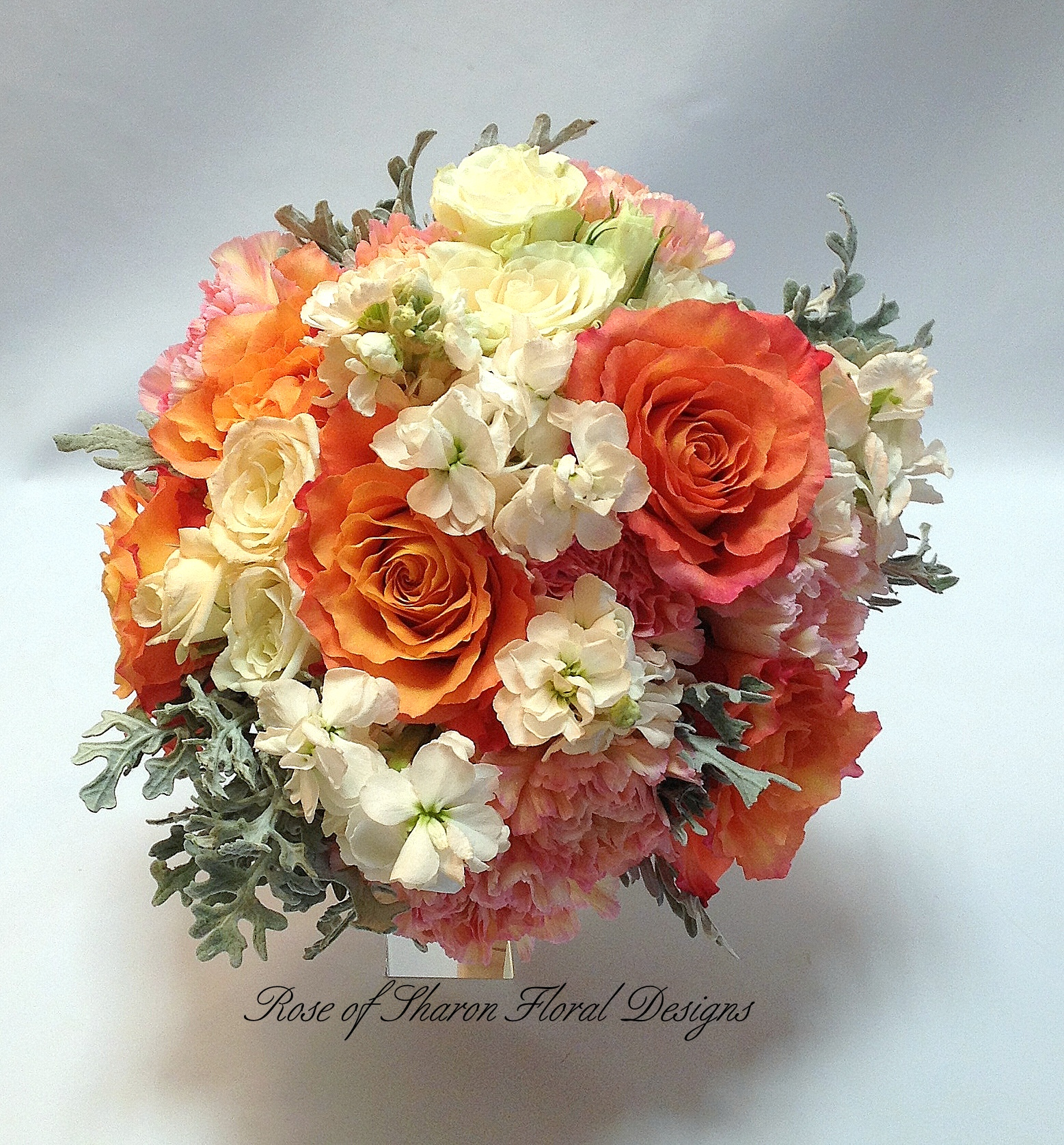 Orange and Cream Hand-Tied Bouquet with Spray Roses, Free Spirit Roses, Carnations and Stock. Rose of Sharon Floral Designs