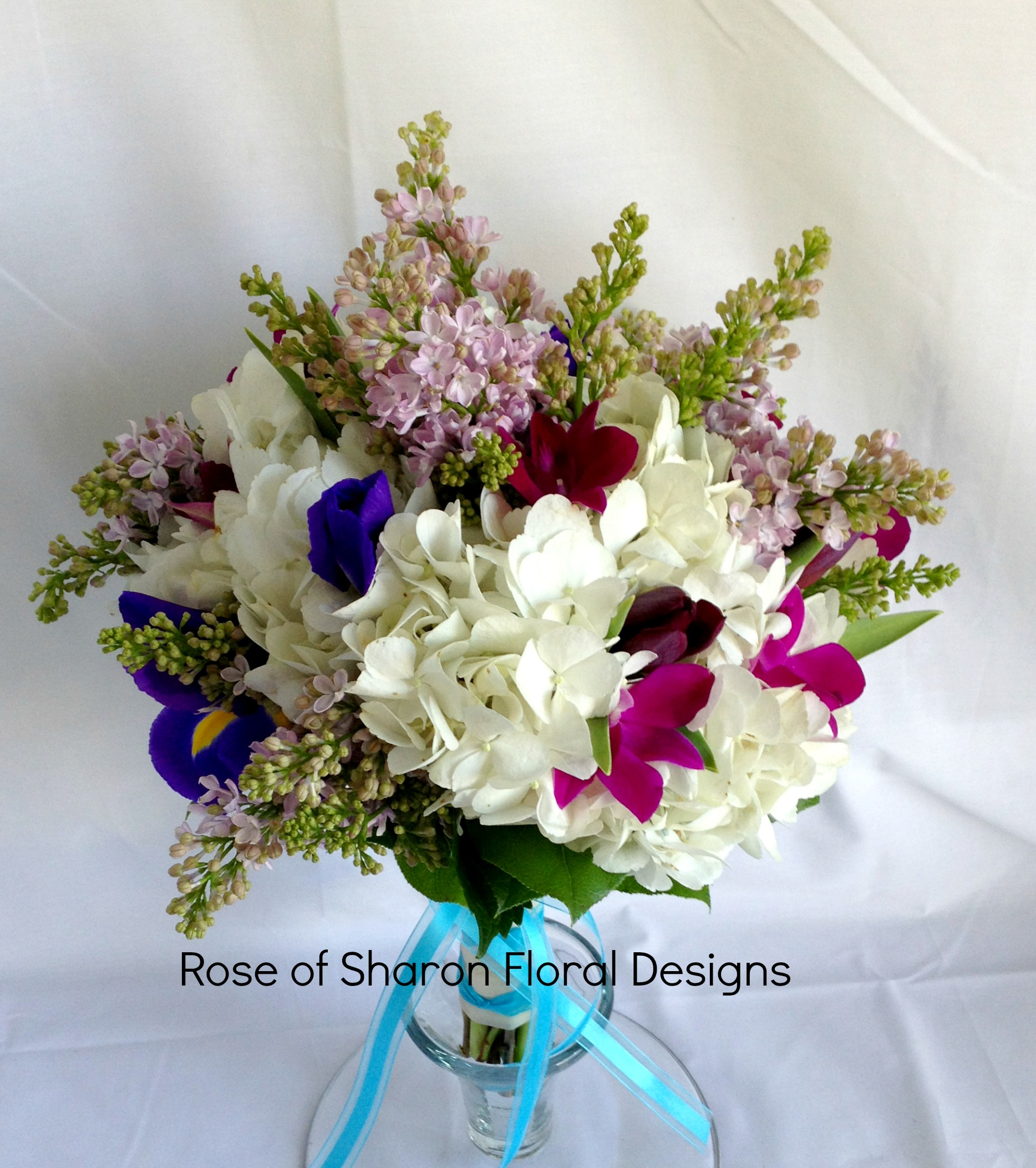 Hydrangea, Stock, Iris and Orchid Bouquets in White and Purple, Rose of Sharon Floral Designs