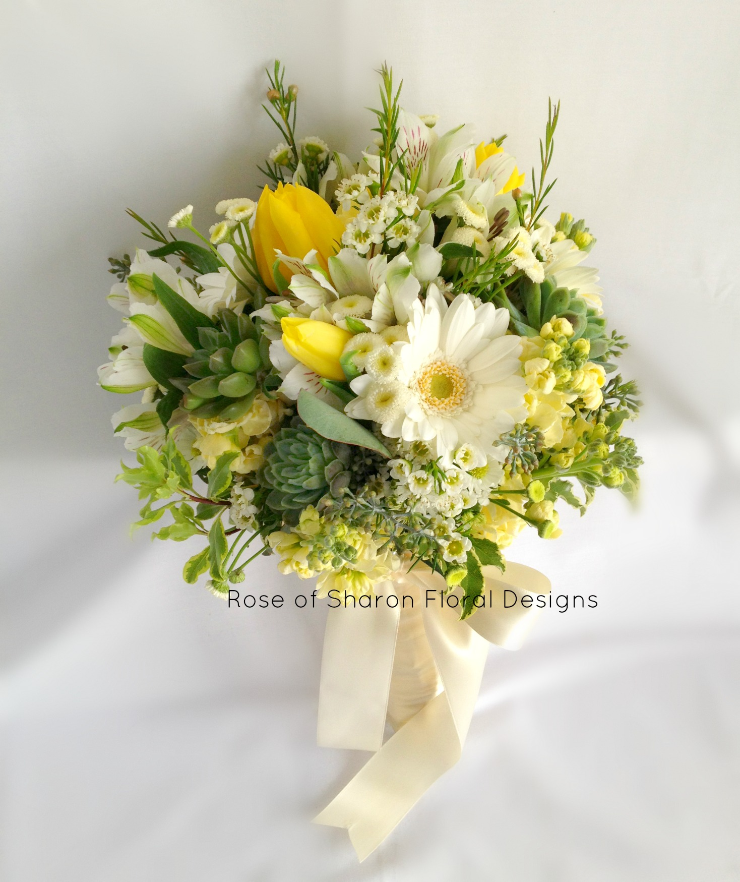 Yellow tulip & stock bouquet with succulents with gerbera daisies. Rose of Sharon Floral Designs