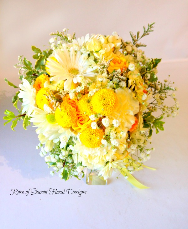 Hand-tied yellow gerbera daisy & button mum bouquet. Succulent & gerbera daisy bouquet with billy balls & eucalyptus. Rose of Sharon Floral Designs