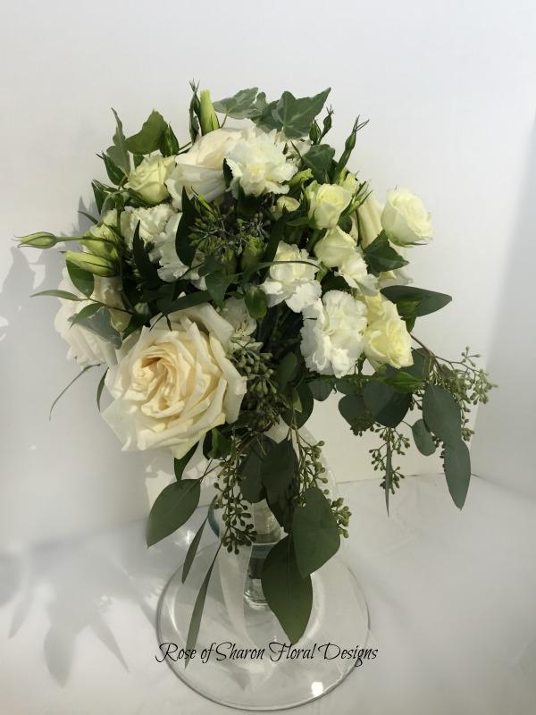 Natural Cascading Bouquet. White garden roses, spray roses, ranunculus & eucalyptus. Rose of Sharon Floral Designs