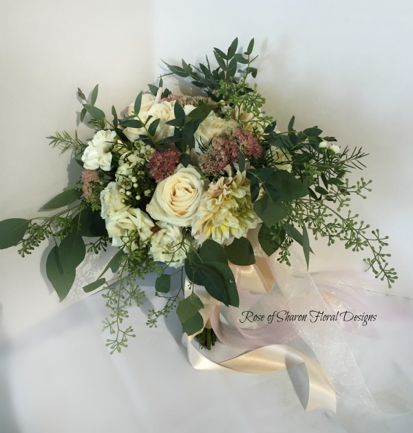 Blush and faded burgundy natural cascading garden bouquet. Roses, dahlias and eucalyptus. Rose of Sharon Floral Designs.