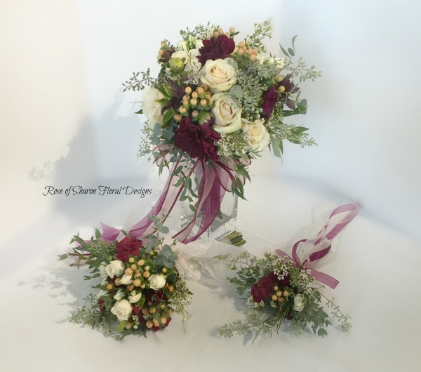 Simi-organic blush & burgundy bouquets. Roses, dahlias & hypericum with eucalyptus. Rose of Sharon Floral Designs