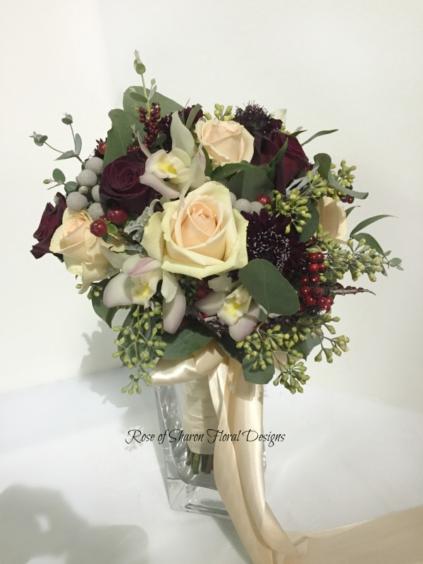 Blush and burgundy bouquet with roses, scabiosa & orchids with eucalyptus. Rose of Sharon Floral Designs