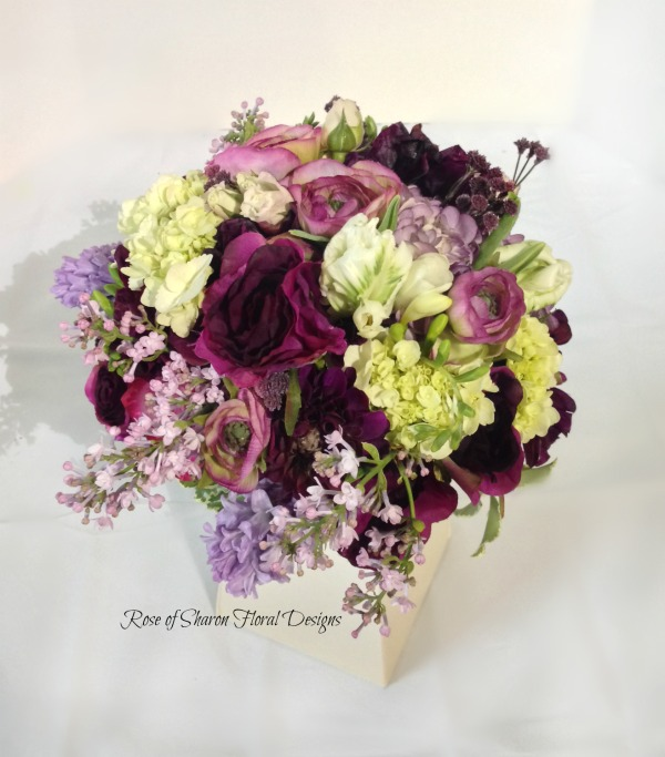 Hand-tied purple bouquet with hydrangeas, lilacs, hyacinths & roses. Rose of Sharon Floral Designs