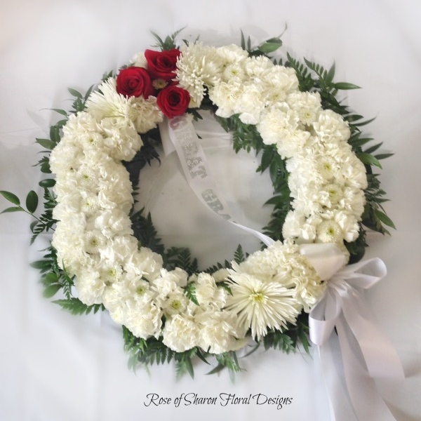 White wreath, red rose accent