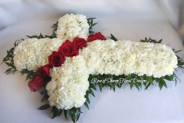 White cross with red roses (casket spray)