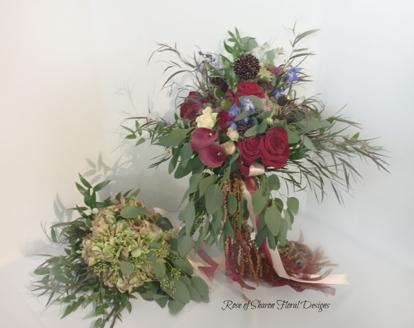 Organic cascading bridal bouquet with roses, calla lilies & eucalyptus. Antique hydrangea & eucalyptus bridesmaid bouquet. Rose of Sharon Floral Designs