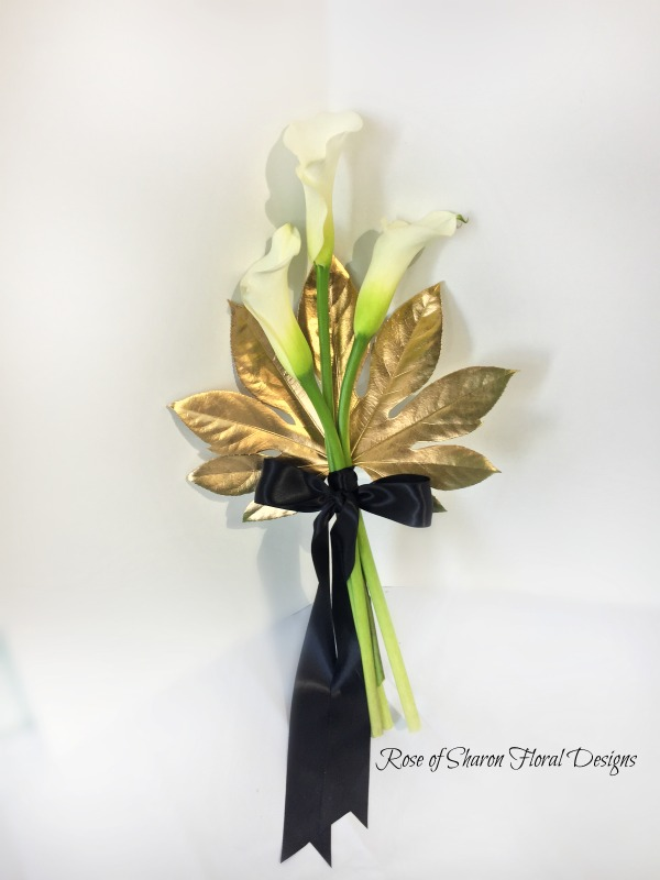 Calla lilies with gold leaf. Rose of Sharon Floral Designs