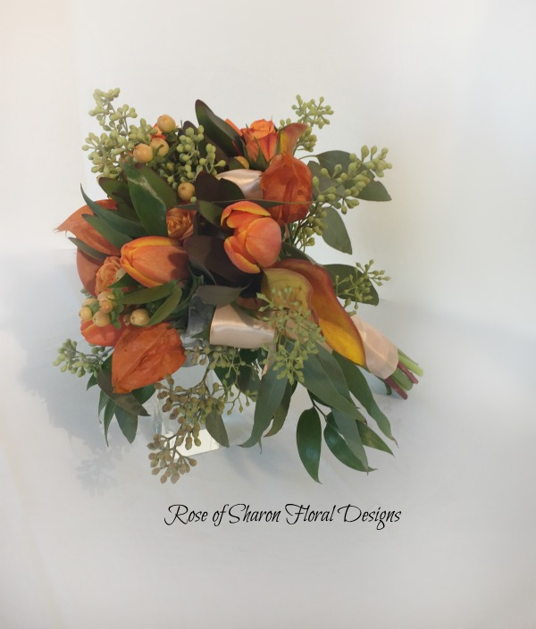 Orange Hand-Tied Bouquet. Tulips, Calla Lilies, and Mixed Foliages. Rose of Sharon Floral Designs