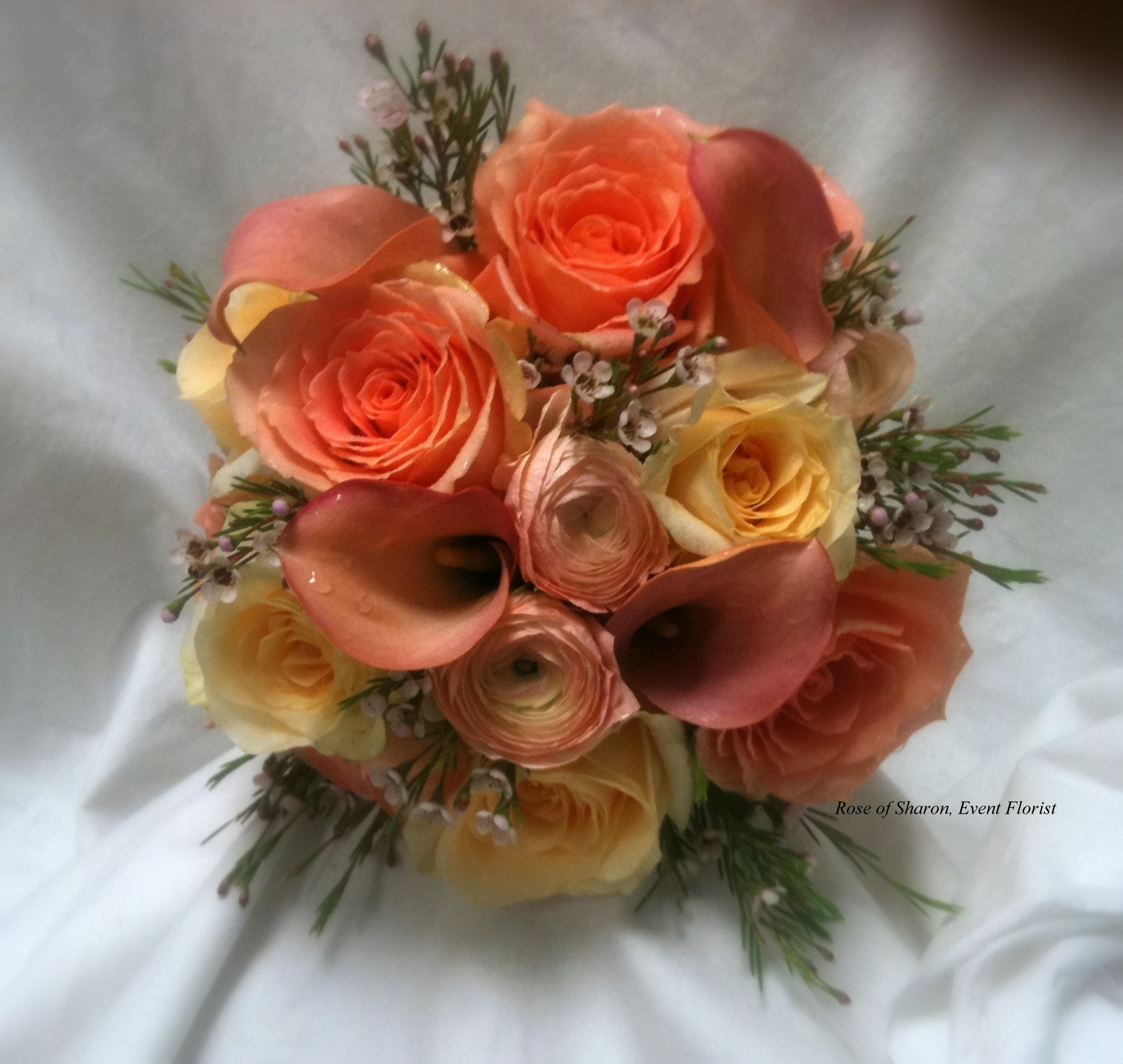 Hand-Tied Round Bouquet. Orange Roses, Calla Lilies, and Ranunculus. Rose of Sharon Floral Designs