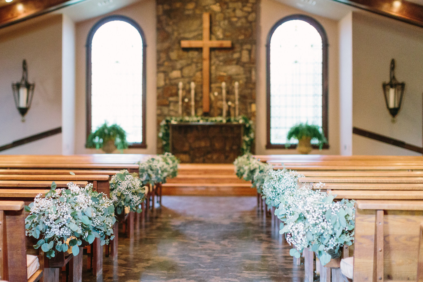 02. Stone Chapel at Matt Lane Eucalyptus aisle. Erin WIlson Photography. Rose of Sharon Floral Designs..jpg
