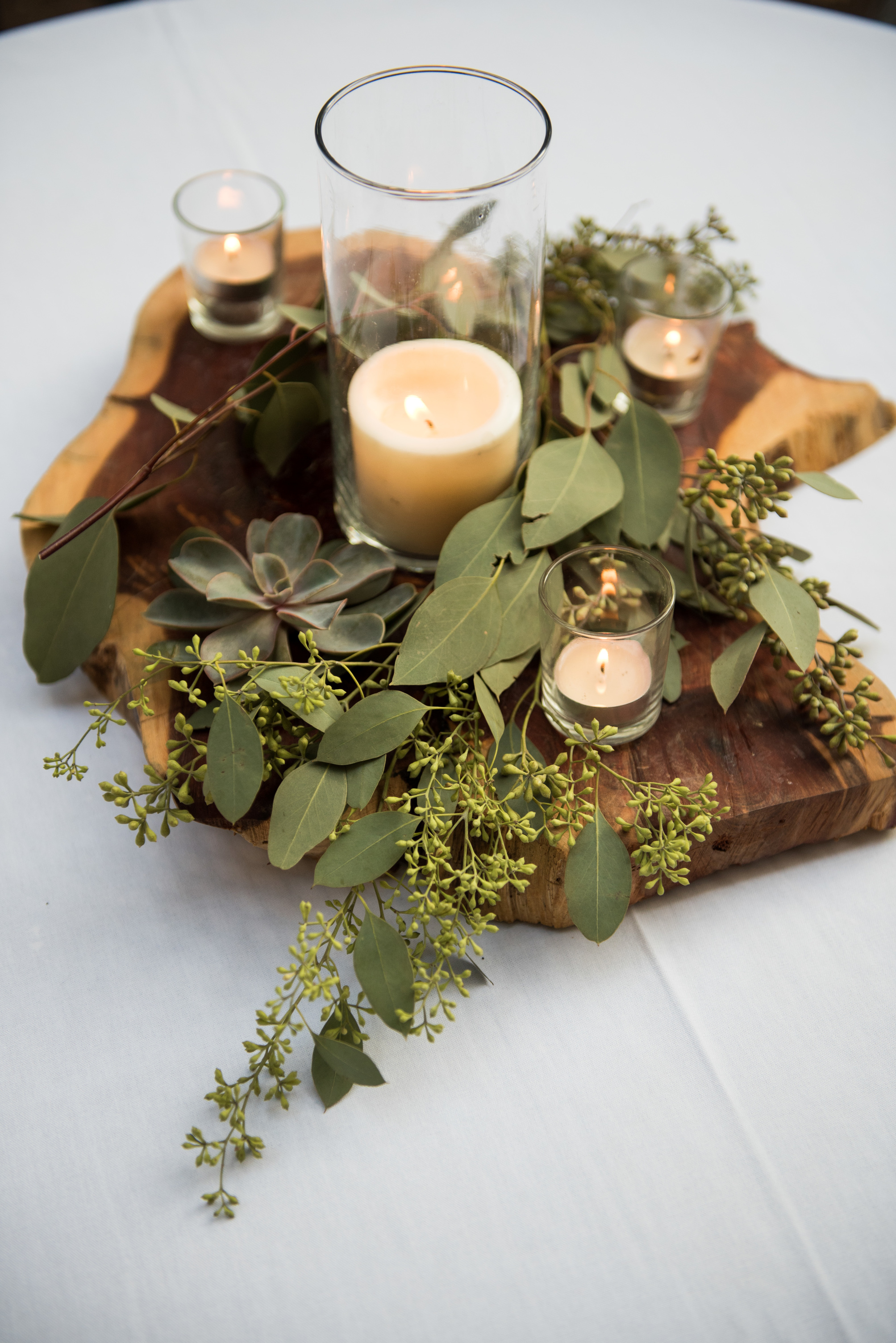 03. 02. Candles, succulents & eucalyptus centerpiece. Lavender + green. Jason Hudson Photography. The Garden Room. Rose of Sharon Floral Designs.jpg