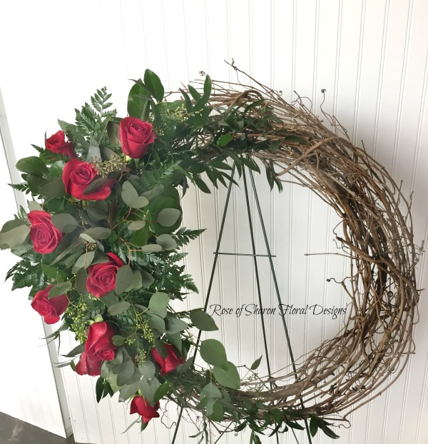 Grapevine wreath with red roses