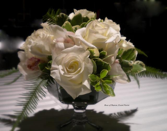 Rose & Orchid compote arrangement designed for Walton Art Center.