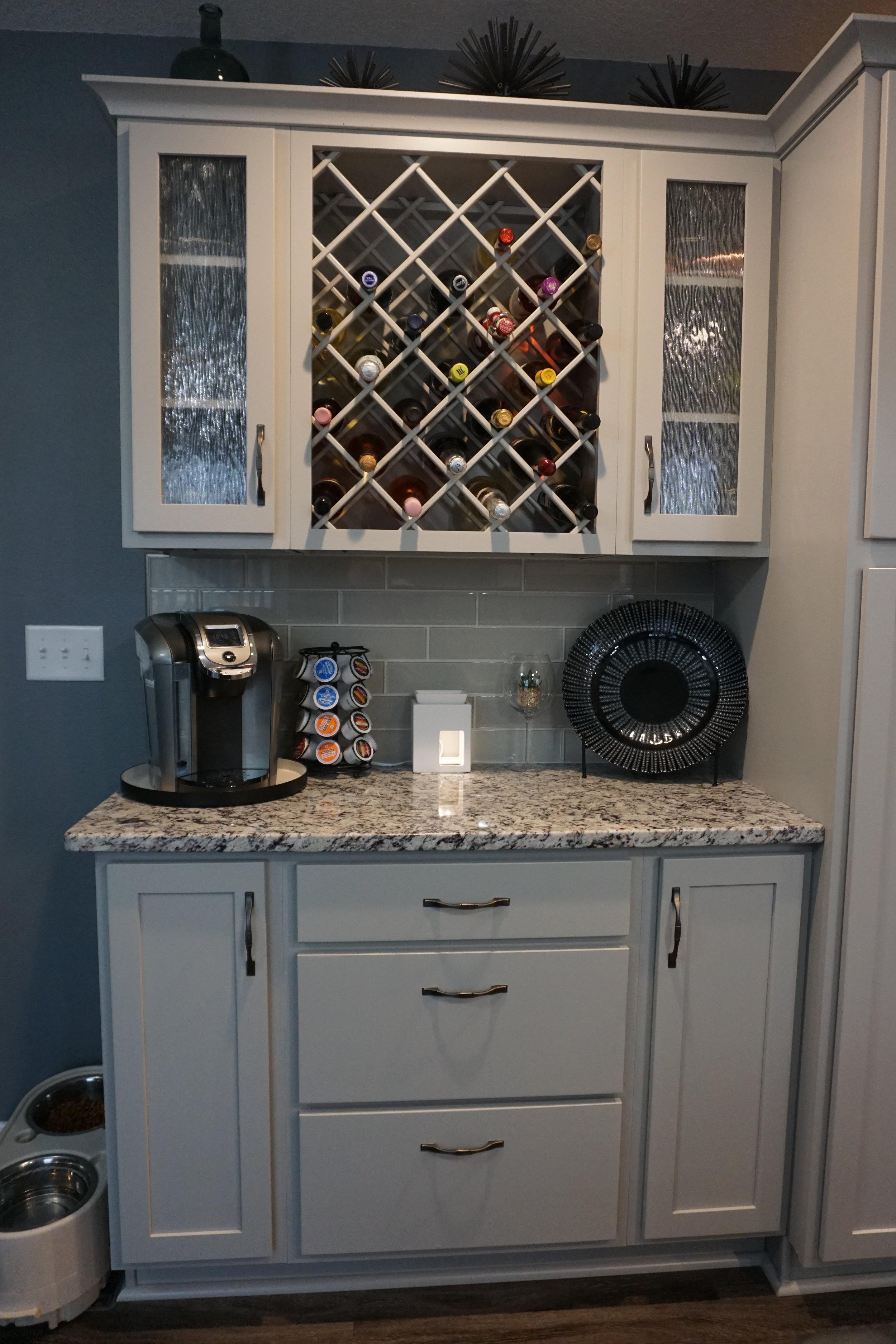 Painted Greystone cabinets, Ashen White Granite, Ceramic Tileworks Studio Glass