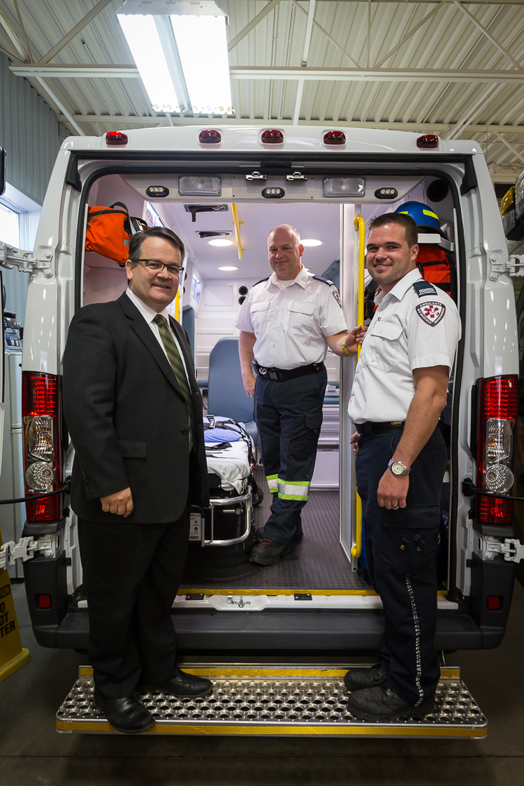 Photo: Photographed with Health Minister Victor Boudreau are paramedics Serge Leblanc (middle) and Jerome Scott (right)